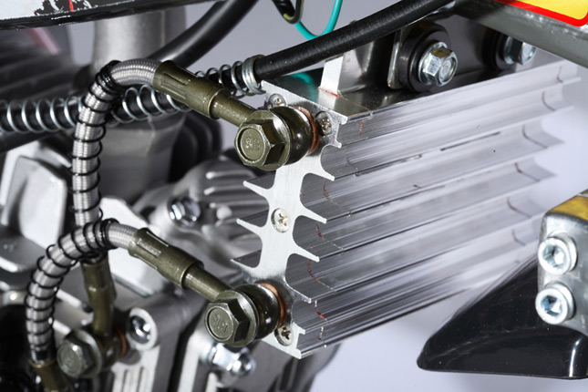 Engine Oil Cooler Works : Oil cooling mechanism in bikes explained bikesmedia